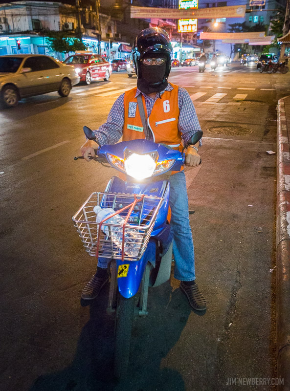 Motorcycle taxi in Bangkok, Thailand. Photo by Jim Newberry.